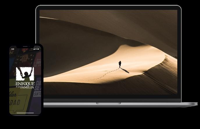 Laptop con una imagen de un hombre caminando por una dunas en el desierto